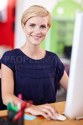 Buy stock photo Cropped portrait an attractive young businesswoman working on her computer