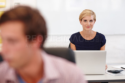 Buy stock photo Cropped portrait an attractive young businesswoman working on her laptop