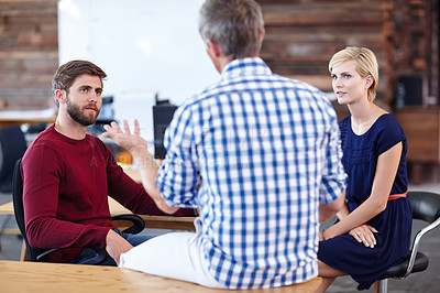 Buy stock photo A group of designers having an informal office meeting
