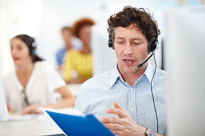 Buy stock photo Cropped shot of a handsome call center operator in the office