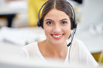 Buy stock photo Cropped portrait of an attractive young call center operator at work