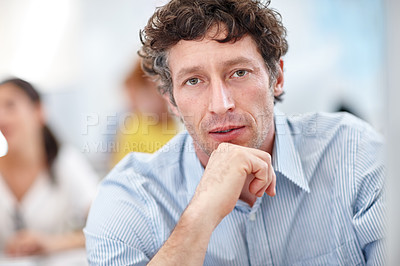 Buy stock photo Cropped shot of a handsome businessman working on his pc