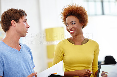 Buy stock photo Cropped shot of two young colleagues working in the office