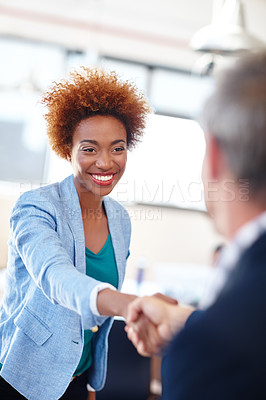 Buy stock photo A mature team leader shaking hands with a colleague