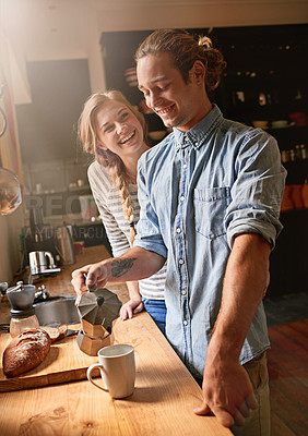 Buy stock photo Cropped shot of a young couple in the kitchen