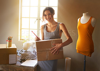 Buy stock photo Shot of a designer getting her designs ready for delivery