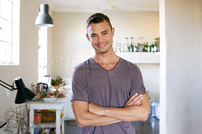 Buy stock photo Portrait of a handsome young man enjoying a day at home