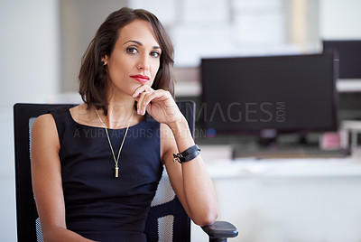 Buy stock photo Portrait of an attractive businesswoman sitting in a chair in an office