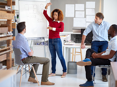 Buy stock photo Shot of a group of designers talking together in a presentation