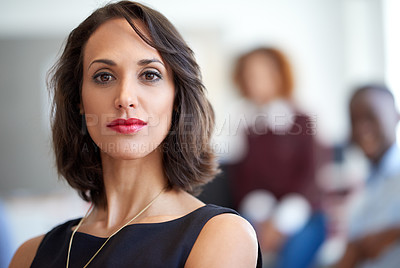 Buy stock photo Portrait of an attractive businesswoman with coworkers in the background