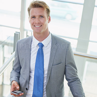 Buy stock photo Portrait of a young businessman holding his cellphone