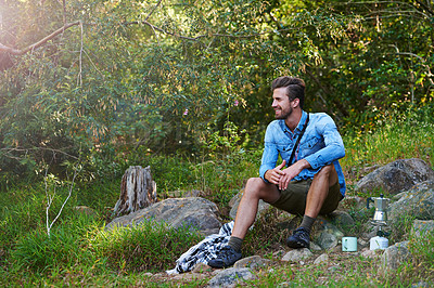 Buy stock photo A young man looking at the nature around him