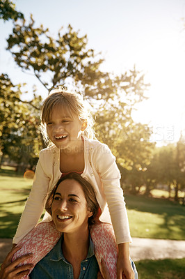 Buy stock photo Shot of a mother and daughter having fun together at the park