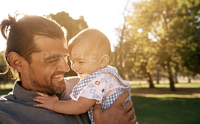 Buy stock photo A handsome young father spending time with his baby