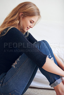 Buy stock photo Shot of a beautiful young woman sitting on her bedroom floor