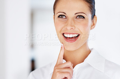 Buy stock photo Portrait of a happy young female business executive looking away at copyspace