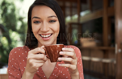 Buy stock photo Cropped shot of a young woman drinking coffee at a cafe