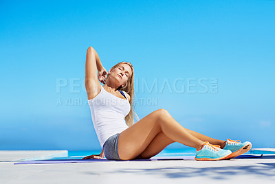 Buy stock photo Shot of a beautiful young woman exercising outside