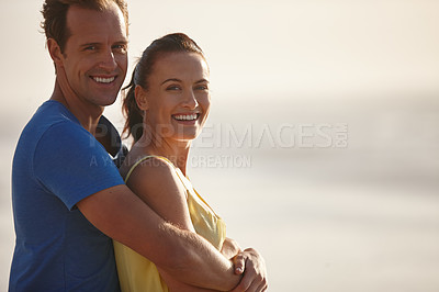 Buy stock photo Shot of an affectionate couple on the beach