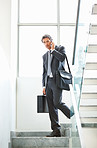 Mature executive carrying bags and talking on cellphone