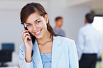 Attractive business woman talking on cellphone