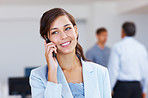 Young female executive talking on cellphone office