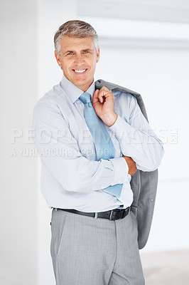 Buy stock photo Portrait of a happy mature business man holding his coat on the shoulders