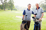 Father and son smiling on golf course