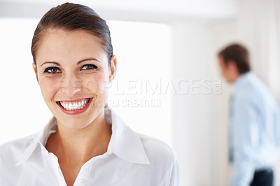 Buy stock photo Portrait of a smiling young businesswoman looking confidently at office
