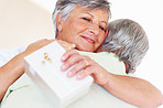 Mature couple hugging after sharing gift