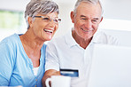 Mature couple shopping online