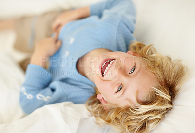 Buy stock photo Closeup portrait of a cheerful boy laughing while looking up