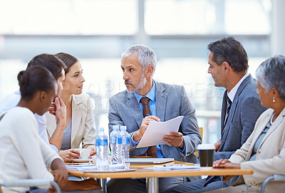 Buy stock photo Shot of a group of businesspeople having a boardroom meeting