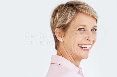 Buy stock photo Portrait of a pretty female business executive looking back and smiling