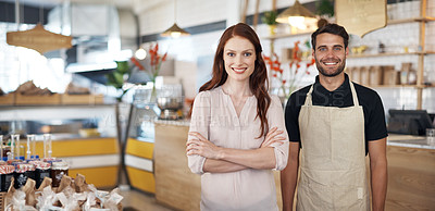 Buy stock photo Portrait of a young business owner and an employee in a coffee shop