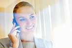 Smiling business woman having a conversation on cellphone