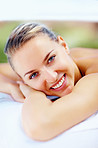 Cute smiling lady at a dayspa relaxing for a beauty treatment
