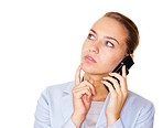 Business woman talking on cellphone looking away in thought