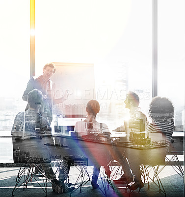 Buy stock photo Shot of coworkers in a meeting superimposed over a cityscape