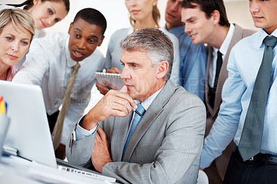Buy stock photo Successful group of businesspeople together working on laptop in a board room
