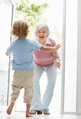 Buy stock photo Full length of a happy mature woman ready to hug her grandson