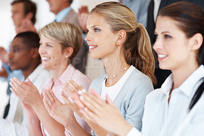 Buy stock photo Happy smiling business team clapping hands during a meeting in office