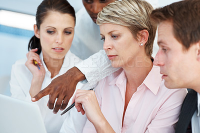 Buy stock photo Portrait of team of diverse business people working together on a laptop at work