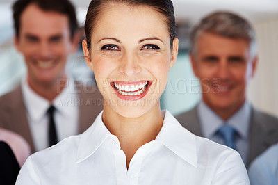 Buy stock photo Closeup of cheerful young businesswoman leading her successful  business team at office