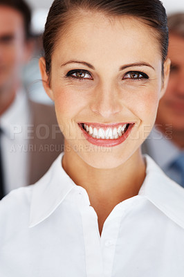 Buy stock photo Closeup portrait of a pretty young businesswoman with colleagues at the background