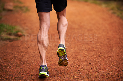 Buy stock photo Shot of a man out for a run in the woods