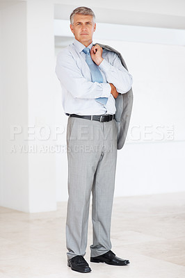 Buy stock photo Full leangth portrait of a mature businessman standing and holding coat over shoulders