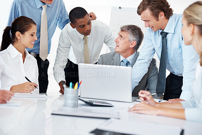 Buy stock photo Portrait of a senior executive discussing new projects with his colleagues on a laptop