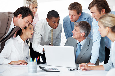 Buy stock photo Group of businesspeople discussing together on laptop at board room