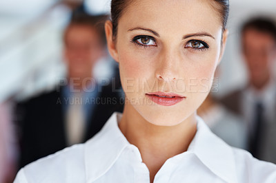 Buy stock photo Closeup portrait of businesswoman with colleagues blur in background